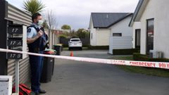 Police stand guard at the scene of the Timaru triple homicide. (Photo / George Heard)