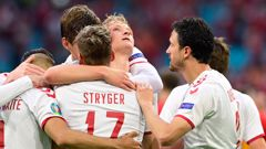Denmark's Dolberg celebrates with teammates after scoring his side's second goal against Wales. (Photo / AP)