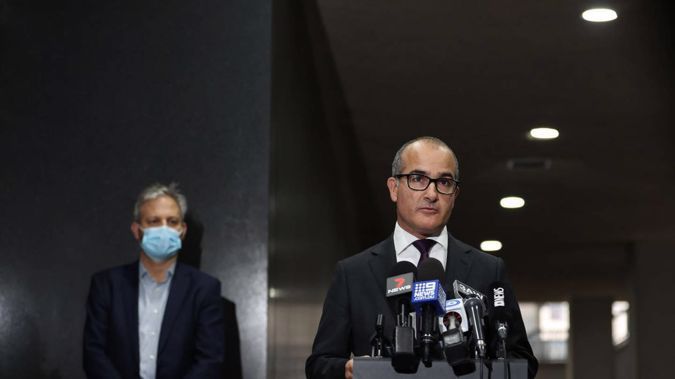 Victoria's chief health officer Professor Brett Sutton and Acting Victorian Premier James Merlino speak to reporters amid the state's latest Covid-19 outbreak. (Photo / AP)