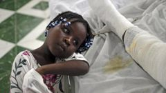 Younaika rests next to her mother Jertha Ylet, who was injured in the earthquake one week prior, at the Immaculate Conception Hospital, Haiti. (Photo / CNN)