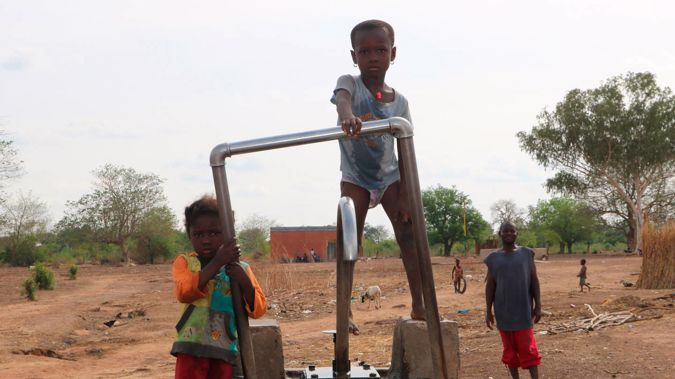 Children play on a water pump in an internally displaced camp in Gaoa, Burkina Faso. (Photo / AP)
