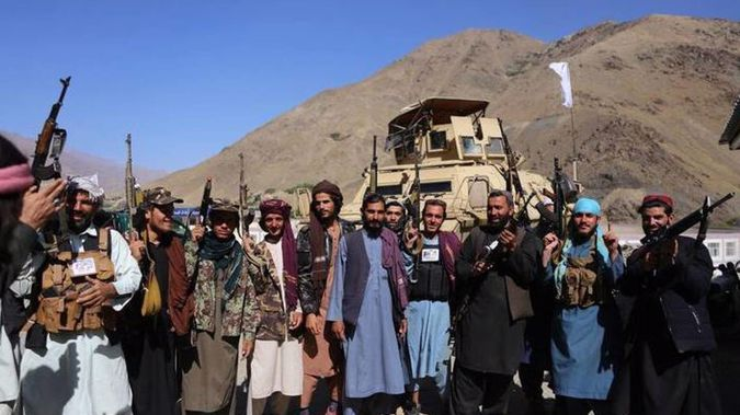 Taliban members pose for a photo after they took over Panjshir Valley. Photo / Getty Images