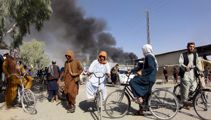 Taliban sweep across Afghanistan's south, take four more cities