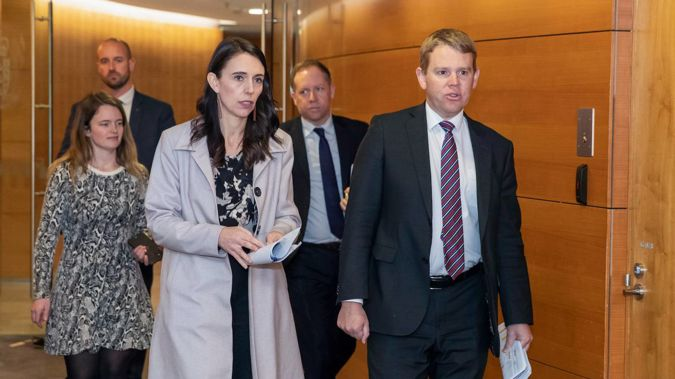 Prime Minister Jacinda Ardern and Covid-19 Response Minister Chris Hipkins arriving for the post-Cabinet press conference at Parliament. Photo / Mark Mitchell