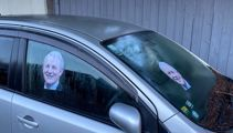 Abandoned car removed after residents attach photos of Phil Goff to it