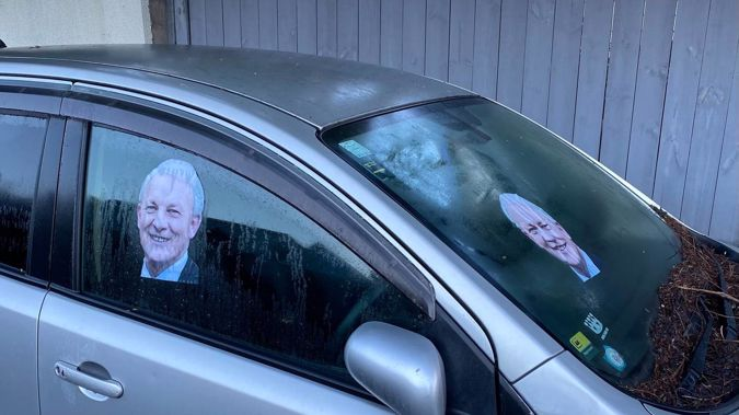 A picture of Auckland mayor Phil Goff adorns an abandoned car in central Auckland. (Photo / Jake Morrison)