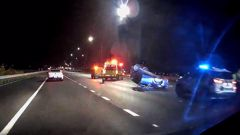 A woman allegedly sped through Auckland's Southern border checkpoint on Sunday morning and flipped her car soon after police used road spikes to stop her. Photo / Hayden Woodward