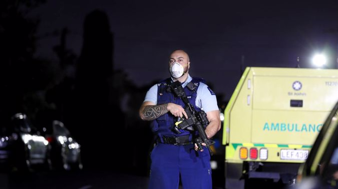 Armed police at the scene in Mt Roskill last night. (Photo / Hayden Woodward)