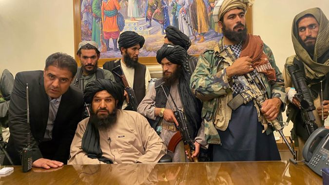 Taliban fighters take control of Afghan presidential palace after the Afghan President Ashraf Ghani fled the country, in Kabul. (Photo / AP)
