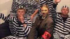 A photo taken at a Christchurch party depicting a group of people apparently dressed as concentration camp victims surrounding an Adolf Hitler-inspired character. (Photo / Supplied)