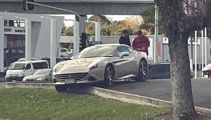 Precariously parked Ferrari draws attention on busy Auckland intersection