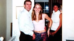 Prince Andrew's team has tried to claim this photograph with Virginia Giuffre is fake. (Photo / Getty)