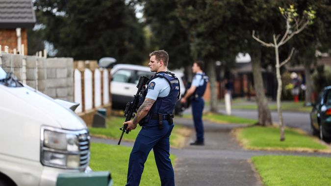 Armed police at the scene of a suspected hit and run incident on Thomas Road Mangere. (Photo / NZ Herald)