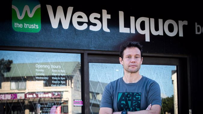 """Pushing for competition: Waltag spokesperson Nick Smale in fron of one of The Trusts' """"West Liquor"""" bottle stores in Te Atatū. Photo / Jason Oxenham"""