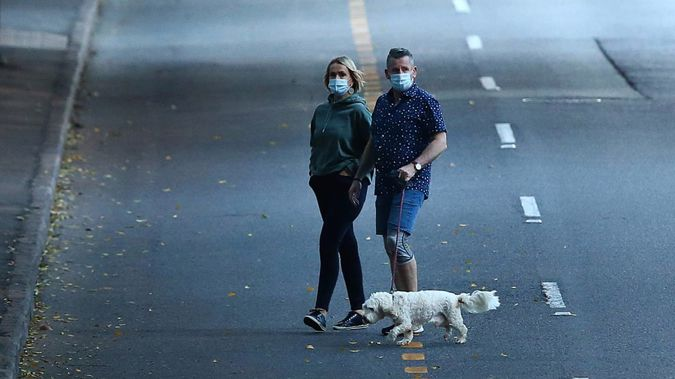 Residents in Brisbane walk near the empty CBD after a snap lockdown was put into effect. Photo / Getty Images