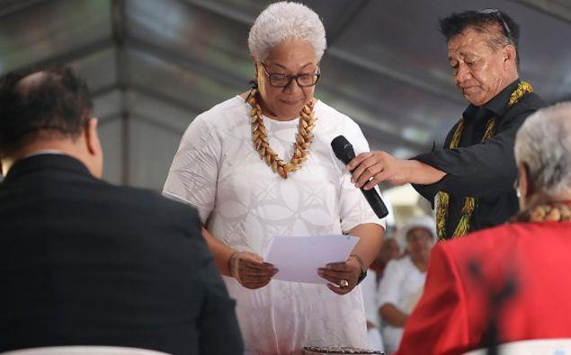 Samoa's Prime Minister-elect Fiame Naomi Mata'afa takes her oath at an unofficial ceremony outside parliament house in Apia, Samoa. (Photo / AP)