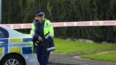 Armed police guard the scene in Beatty St, Ōtāhuhu, on Sunday. (Photo / Hayden Woodward)