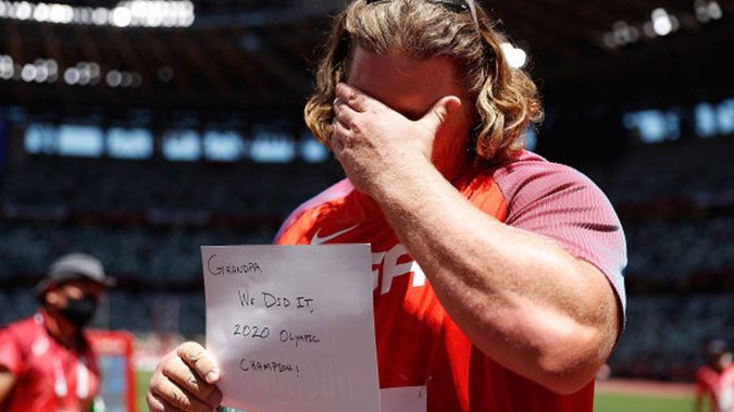 Ryan Crouser of the United States displays a message after winning the men's shot put final. (Photo / Getty)
