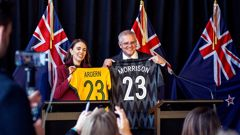 Prime Minister Jacinda Ardern and Australian Prime Minister Scott Morrison swap football jersey's during a dual Prime Ministers press conference in Queenstown. (Photo / Getty)