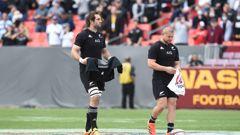 Sam Whitelock and Dane Coles carry jerseys as a tribute to Sean Wainui. (Photo / Photosport)