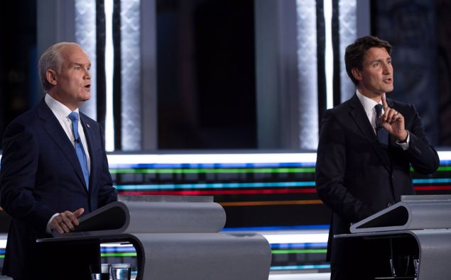 Conservative leader Erin O'Toole, left, and Liberal leader Justin Trudeau speak during the federal election French-language leaders debate in Gatineau, Quebec. (Photo / AP)