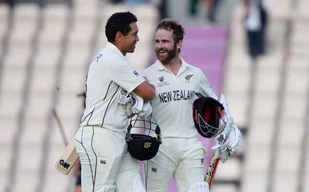 New Zealand's captain Kane Williamson, right, and Ross Taylor celebrate their win on the sixth day of the World Test Championship final. (Photo / AP)
