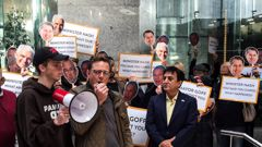 Local business owners and workers demonstrate outside the Auckland Council offices on Albert St. (Photo / Bernard Orsman)