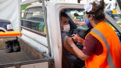 A ute driver gets his Pfizer jab at Papakura Marae's drive-through vaccination centre on Super Saturday. (Photo / Sylvie Whinray)