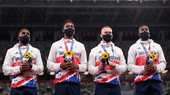 4x100m relay silver medal winners Chijindu Ujah, Zharnel Hughes, Richard Kilty and Nethaneel Mitchell-Blake of Team Great Britain. (Photo / Getty)